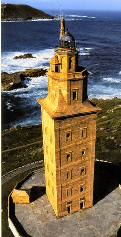 "The Tower of Hercules is an ancient Roman lighthouse on a peninsula about kilometers from the centre of A Coruña, Galicia, in north-western Spain. Until the century, the tower itself was known as the ""Farum Brigantium"". Lighthouse Pictures, Beacon Of Light, Spain And Portugal, Am Meer, Mellow Yellow, World Heritage Sites, Beautiful Places, Places To Visit, Around The Worlds"