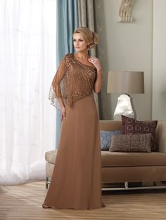 I like this dress in the champagne color.  We can order this from Maya's Palace here in Tucson.  Montage by Mon Cheri   Evening Gowns style #212955