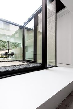 Renovation and extension of Manor House S by Belgian office Caan Architecten. I like how the white slab establishes a datum for the whole extention, both inside and outside.