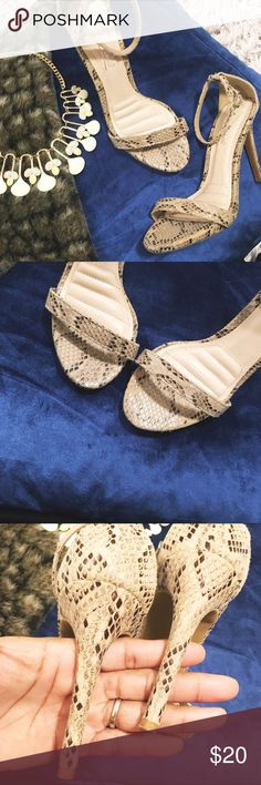 ✨ Faux Snakeskin Sandal Heels ✨ Cute one strap heels with a sexy snakeskin pattern. Never worn without box/tags. Will go perfect with any dress or a pair of jeans! Super versatile and for a great price!  💁🏾✨Happy Poshing!😀  🌟 Suggested User 🌟 🙋🏾 Top 10% Sharer/Mentor ⭐️⭐️⭐️⭐️⭐️ 5 star Gal 📫 Fast Shipper!  Ships Same/Next Day📦  🏡 Odor Free 🐩 Pet Free 🚫 PayPal/Trade/low ball offers 💪🏾 Price is Firm Shoes Heels