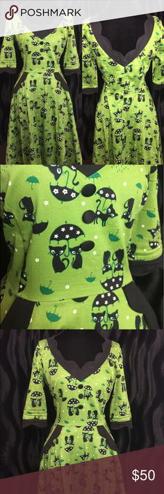 Voodoo Vixen Pinup Black Cats in the Rain Dress This cat dress is adorable! Black cats and umbrellas! This dress has wide shoulders and small fitting sleeves. Dress fits like a US size Large. Shoulders: 16 Bust: 36/38 Waist: 32 💚 Voodoo Vixen Dresses Midi