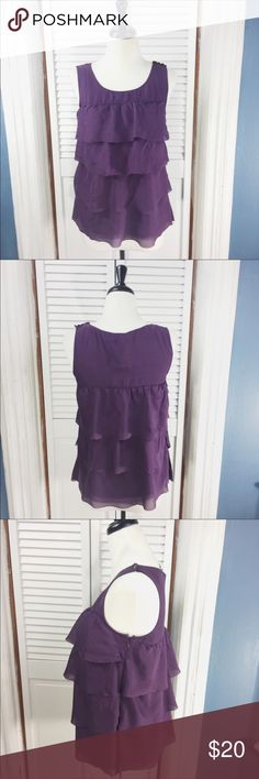 """J. Crew Silk Tiered Ruffled Sleeveless Purple Top J. Crew Silk Tiered Ruffled Sleeveless Top Size 2. Very versatile. Can be dressed down or dressed up. The tiered ruffles go all the way around the bodice. There's a hidden zipper on the side. Embellished with 3 buttons on left shoulder. Fully lined (100% polyester). Dry clean only. Approximate measurements (measured flat): Chest: 16.5""""; Length (shoulder to hem): 26"""". Excellent used condition. No signs of wear. J. Crew Tops"""