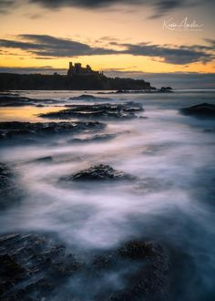 Tantallon Castle and sea mist from Seacliff Beach in Scotland.