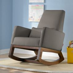 A chair designed for you and your little bundle of joy. Deep and comfy, it gently rocks back and forth on solid walnut legs. And, like all of our upholstered seating, its look will work in any room when baby makes the move to big kid bed.