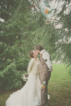 I like the idea of wearing a little cardigan over my wedding dress too-- maybe even in a shade of soft soft powder blue...