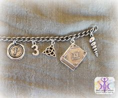 "Show your love of the TV show ""Charmed"", with this Charmed Inspired Charm Bracelet from Inked Goddess Creations. This charm bracelet includes charms that represent the Halliwell sisters and their stor"