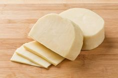 Full of flavor and creamy in texture, this Provolone white cheese is usually served in thin slices on sandwiches, crackers, or topping a pasta dish. Cheese Curds, Provolone Cheese, Cheese List, Cheese Online, Aged Cheese, Sandwich Trays, Protein Packed Snacks, White Cheese, Types Of Cheese