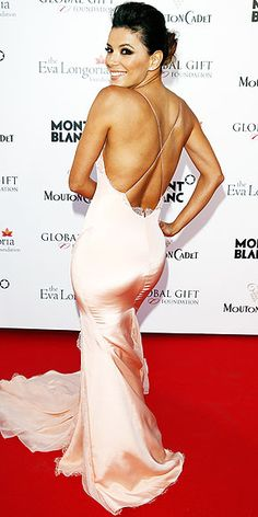 On the Red Carpet at Cannes | EVA LONGORIA | It takes a flawless figure to pull off an unforgiving, pale-peach, body-skimming, lingerie-esque custom Gabriela Cadena gown with a plunging back. Luckily, Eva's got just that and she shows it off at the Global Gift Gala.