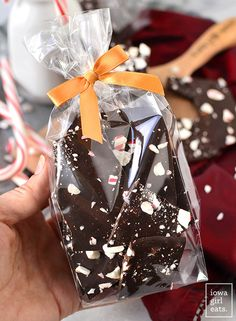 Dark Chocolate Peppermint Bark couldn't be simpler & is perfect for holiday snacking. Package up and tie with a bow for a sweet homemade gift! Homemade Chocolate Bars, Chocolate Peppermint Bark, Hot Chocolate Gifts, Chocolate Bark, Christmas Food Gifts, Christmas Sweets, Christmas Candy, Christmas Cookies, Chocolate Wrapping