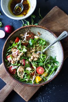 A quick and easy recipe for Tuscan White Bean & Tuna Salad with arugula, radishes, seasonal tomatoes and a simple balsamic vinaigrette. A simple 15 minute pantry meal! #salad #healthysalad #tuscansalad #tunasalad #whitebeansalad