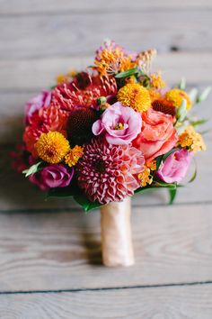Perfect Fall Bouquet. In fact this whole wedding has a perfect fall color palette! Drooling begins here on SMP -- http://www.StyleMePretty.com/2014/01/28/colorful-fall-germany-wedding-at-gut-sonnenhausen/ Carmen And Ingo Photography