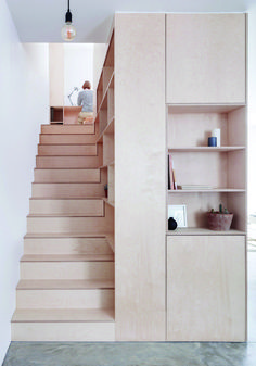 A great example of a maisonnette converted around a minimalist plywood kitchen
