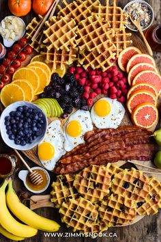 Blueberry & plain waffles, bacon, eggs, a selection of fruit, maple syrup, honey, almond slivers & granola. I made an extra 40 waffles to freeze and share with family. My mom & dad especially love them for an easy breakfast treat. #brunch #breakfast #waffles #blueberrywaffles #belgiumwaffles #bacon #eggs #baconandeggs #fruit #berries Blueberry Waffles, Buttermilk Waffles, Belgium Waffles, Breakfast Waffles, Board Ideas, Maple Syrup, Freeze, Granola, Almond