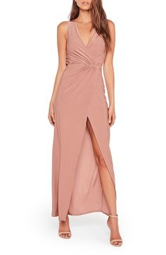 Free shipping and returns on Missguided Surplice Split Hem Maxi Dress at Nordstrom.com. A wrap-style maxi dress cut from slinky fabric in the perfect shade of faded rose shows off your neckline and legs thanks to a generous surplice neckline and sky-high side slit.