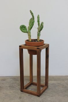 Solid walnut planter stand, designed to fit a standard 7 terracotta pot.