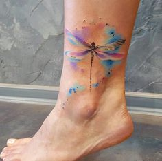 Watercolor dragonfly tattoo on ankle by Simona Blanar