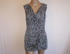 A.B.S. By Allen Schwartz Sleeveless Cowl Neck Stretchy Animal Print Tunic. This A.B.S. by Allen Schwartz Sleeveless Cowl Neck tunic is one of Tradesy's Top Ten deals of the week!