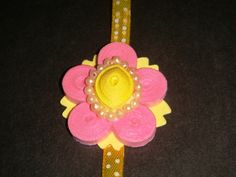 """HANDMADE RAKHI FOR INDIAN FESTIVAL -""""RAKSHA BANDHAN""""-where sister rie this rakhi on hand of brother ,and brother takes promise to take care of him for whole life.it is celebrated by great joy and enthusiasm by every sibling.many design's can be made."""