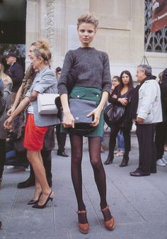 Shop this look on Lookastic:  http://lookastic.com/women/looks/dark-green-mini-skirt-and-black-satchel-bag-and-charcoal-crew-neck-sweater-and-brown-heels/1658  — Dark Green Mini Skirt  — Black Leather Satchel Bag  — Charcoal Crew-neck Sweater  — Brown Leather Pumps