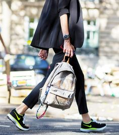 Nikes dress down this outfit for a casual look paired with a Chanel backpack. // Photo: The Styleograph #Streetstyle #PFW