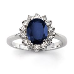 This beautiful 3 carat genuine sapphire ring looks just like the Royal engagement ring. The oval-shaped center stone is surrounded by 14 diamond-like sparkling cubic zirconia. This ring is an absolute