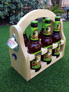 magnetic beer caddy made from red oak. holds 6 standard beer bottles. options for bigger holes (for IPAs, sierra nevadas, etc.) are available. hidden