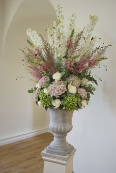 Large ceremony Urn Arrangement | Flowers designs created for Farnham Castle Weddings and Events located in Farnham, Surrey by Hannah Berry Flowers www.hannahberryflowers.co.uk