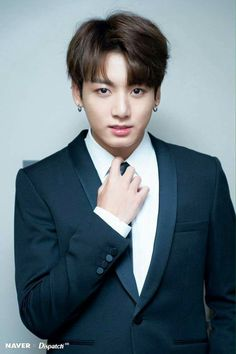 Jungkook started walking towards you while unbottoning his tux