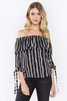 """Stripes and ruffles galore! We adore our Katherine Off The Shoulder Top and will be wearing this all season! Pair with flare jeans and delicate necklaces for a stylish look!    - Stripe off the shoulder top with double layered ruffle  - 3/4 Tie sleeve  - Elastic top  - Color: White/Black    Size + Fit  - Model is wearing size S  - Measurements taken from size S  - Length: 18""""    100% Polyester. Hand Wash Only    Ships Free and Fast! 