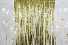 Wider tassel backdrop! Sure they'll have it at the dollar store in my school colors! Clear balloons on the side. Should be cheap! Cute!!
