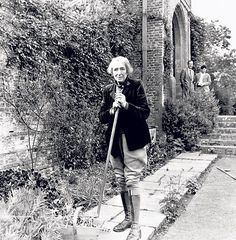 """Vita Sackville-West working in the gardens at Sissinghurst Castle, Kent. She once described her approach to garden design as, """"profusion, even extravagance and exuberance, within confines of the utmost linear severity."""""""