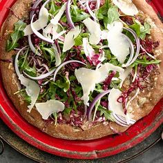 This salad pizza #recipe (YES, salad pizza) gives you refreshing greens and gooey cheese! Arugula and Radicchio Salad Pizza | Health.com