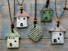 Love these house & leaf necklaces