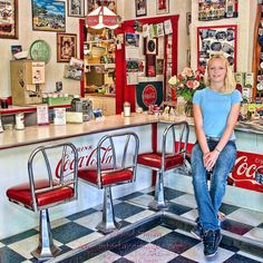 Yound blonde teenager wearing blue jeans and light blue shirt sitting on stool in 1950's style soda fountain with Coca Cola antiques and red and white memorabilia Visit http://ift.tt/1thqi0O link in bio for more fine art images fun travel photo Blog image licenses and photography classes. Cheers! #coke #cocacola #cafe #retro #travelstoke #opt2travel #photooftheday #picoftheday #1950s #red #model #waitress #instagood #maltshop #wow
