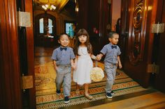 Awww! Every entrance is a grand entrance though the doors of the lavish historic ballroom. Milou Olin photography.