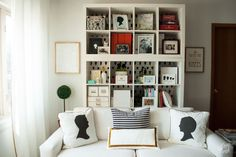Great Book shelves with wall paper behind