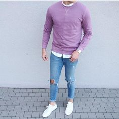 The versatility of a lavender crew-neck pullover and light blue ripped skinny jeans makes them investment-worthy pieces. A pair of white low top sneakers will seamlessly integrate within a variety of outfits.