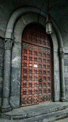 Old wood front door in Barcelona, Spain.