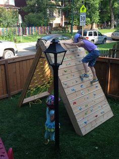 Do-it-yourself kid's climbing wall with Rock Wall and Cargo Net. Complete step-by-step instructions with lots of photos available here: http://mincingthoughts.blogspot.com/2015/07/kids-climbing-play-structure-building.html