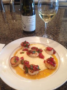 Scallops with cherry pepper relish over grits