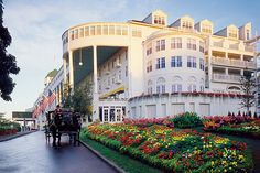 Have spent several Spring & Fall Christian Win-Some Women Retreats here.  The Grand Hotel on Mackinac Island, Mic higan is a fabulous piece of history and a wonderful hotel also. The longest front porch in the world. Horse drawn buggies, wagons etc are the only mode of transportation on the island, which is accessed by ferry.  No bridge!