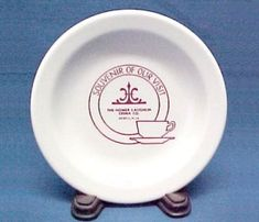 Homer Laughlin China Advertising Souvenir Plate. Heavy porcelain, Ivory color, Maroon Company Name and Logo, Silhouette of Cup and Saucer.