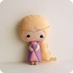 Rapunzel doll that I MUST incorporate into the girls' Tangled room! Super cute!