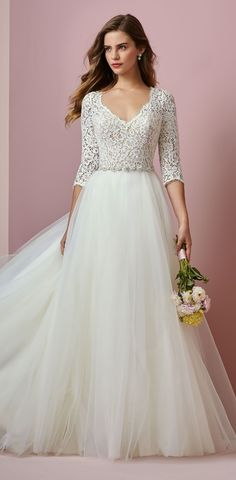 """#AD This one has """"princess"""" written all over it! SCARLETT wedding gown from Rebecca Ingram, @maggiesottero value-conscious bridal line. This soft and romantic wedding dress features an allover lace bodice with three-quarter sleeves, a V-neckline, and a keyhole back. From the Fall 2018 """"Camille"""" bridal collection. #RebeccaBride #RebeccaIngram #MaggieSotteroDesigns #Sponsored #WeddingDress #WeddingGown #Bridal #Wedding #Sleeves #Lace"""