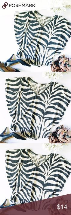 Incense Zebra Print Top with Flared Sleeve The sleeves are just so beautiful on this top. Take a walk on the wild side with this black-and-white zebra top. Bundles okay. L 20 W 22 60% polyester 35% rayon 5% spandex incensce Tops