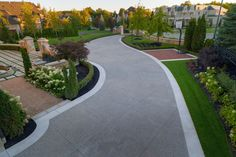 A photo Gallery of stunning concrete. Bomanite of Toronto installs beautiful Bomanite decorative concrete using Exposed Aggregate, Imprint, Polishing, and Toppings Systems. The concrete is not only stunning but durable. Stained Concrete Driveway, Concrete Driveways, Exposed Aggregate, Driveway Design, Concrete Design, Back Patio, Decorative Concrete, Bellisima
