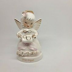 """Adorable Napco Birthday Angel June Figurine. Spaghetti trim and holding what looks like a wedding cake with gold rings on top. Trimmed in gold. Condition. Small chip on the flower on her head. Not really noticeable but I can feel it. No other noted chips, cracks or crazing. Measure approx 4 1/2"""" tall. This will be shipped in a box to ensure safe arrival. Birthday Angel, Birthday Month, Vintage Planters, Girls Characters, Poinsettia, Wedding Cake, Elf, Spaghetti, Gold Rings"""