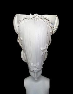 I love this collection of paper wigs, a la Marie Antoinette, by Atlanta-based duo Amy Flurry and Nikki Salk.