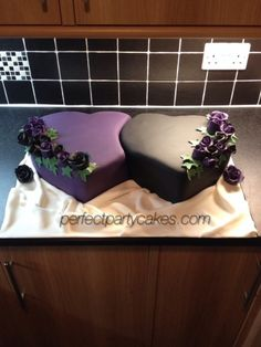 Something a little different. Black and Cadbury's Purple Heart entwined wedding cake