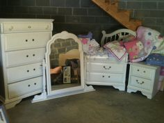 girls bedroom set in Noe_moving_sales Garage Sale in Hanceville , AL for $400.00. Girls french provencial white bedroom set 2 twin headboards, 1 dresser, 1 dresser with vanity mirror, 1 bed side table.  All wood, needs new knobs